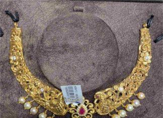 kante peacock necklace