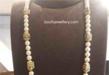 pearl necklace with lakshmi pendant