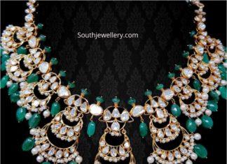 flat diamond and emerald necklace