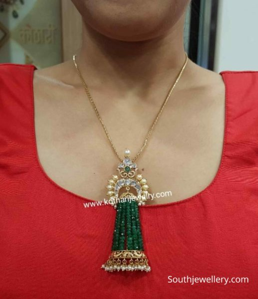 gold chain with emerald beads tassel pendant