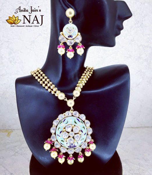 meenakari gold pendant and earrings