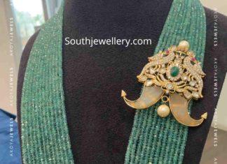 multi strand emerald beads mala with puligoru pendant