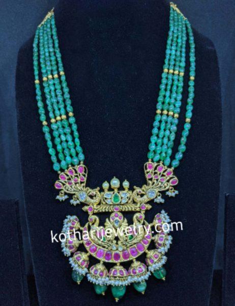 emerald green beads haram