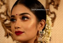 diamond emerald choker and jhumkas