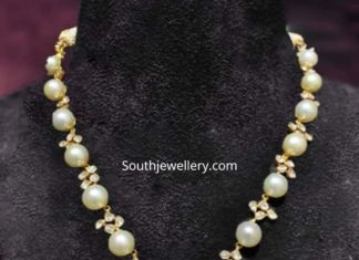 south sea pearl necklace with carved ruby pendant