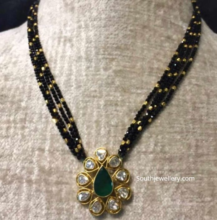 black diamond necklace with uncut pendant