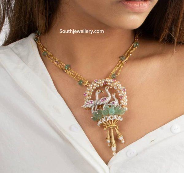 gold chain with diamond bird pendant