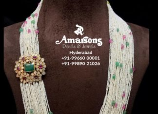 multi strand pearl haram with floral side pendant