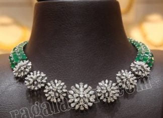 simple diamond and emerald necklace