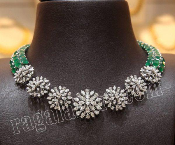 simple diamond and emerald necklace