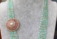 layered emerald beads mala with side pendant