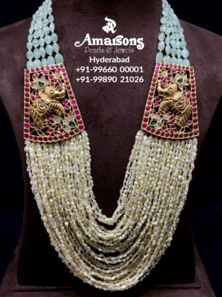 multi strand pearl haram with elephant side pendants