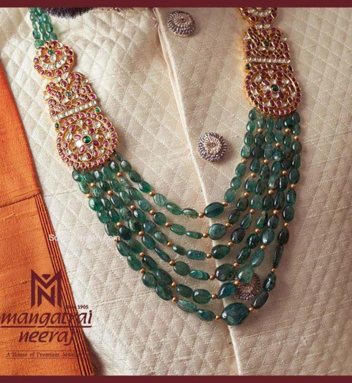layered emerald beads necklace with kundan side pendants