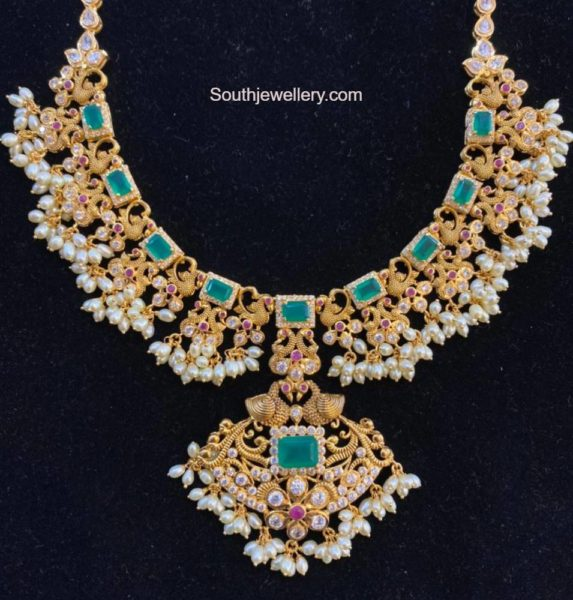 peacock gold necklace with emeralds