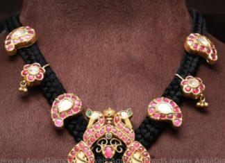 black thread necklace with lakshmi pendant