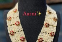 multi strand pearl haram with floral kundan motifs