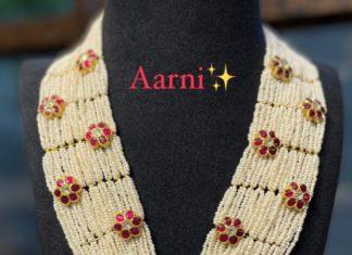 multi strand pearl haram with floral kundan motifs
