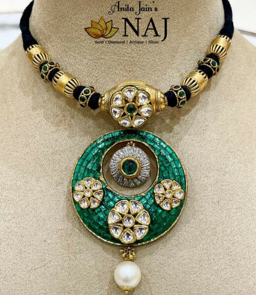 black thread necklace with emerald pendant