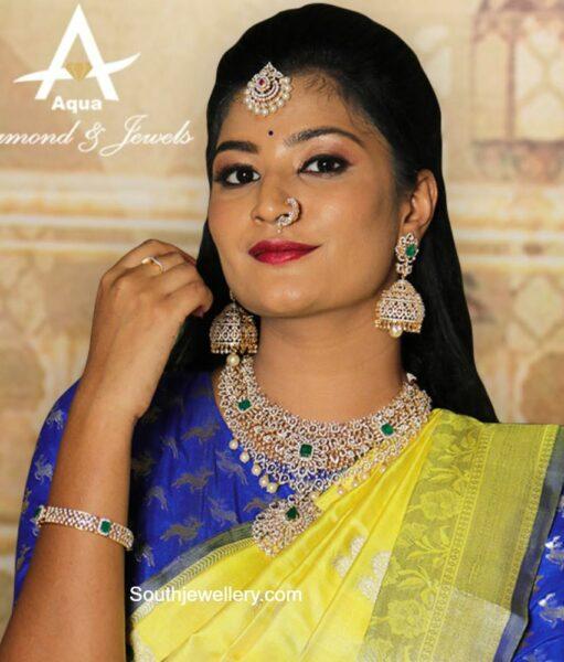 diamond emerald necklace and jhumkas set