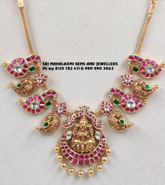 peacock kundan mango necklace with lakshmi pendant
