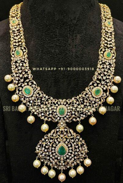closed setting diamond and emerald haram