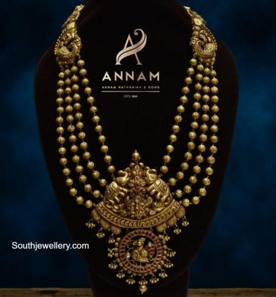 layered gold balls haram with elephant pendant