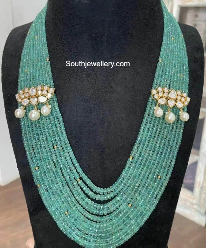 multi strand emerald beads haram with polki side motifs akoya
