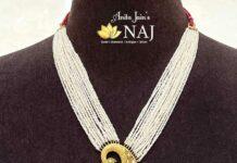 multi strand pearl haram with paisley pendant